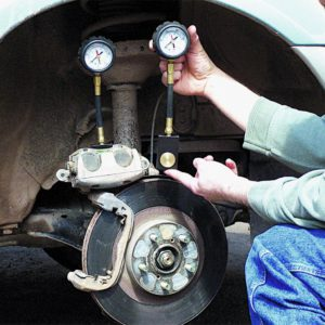 identifying uneven brake pad wear and imploded brake hoses